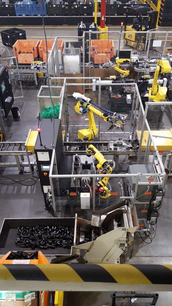 Bushing Press with Bushing Orientation Robot and pallet conveyor Load/Unload Robot
