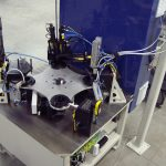 Bearing bracket plug assembly and leak test machine.