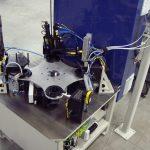 Bearing bracket plug assembly and leak test machine.