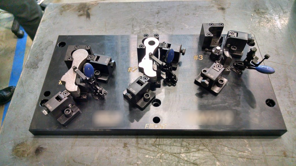 Workholding fixture with sideclamps